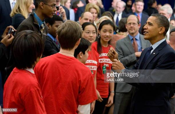 President Barack Obama greets local area students during an event highlighting several initiatives designed to boost science, technology, engineering...