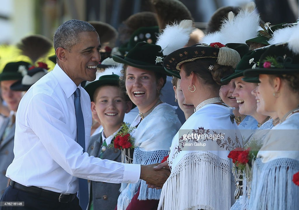 U.S. President Barack Obama greets locals dressed in traditional Bavarian folk dress while strolling with German Chancellor Angela Merkel (not pictured) in the village center before the two leaders were scheduled to continue to the G7 summit at Schloss Elmau on June 7, 2015 in Kruen, Germany. The leaders of the U.S.A., Germany, France, Great Britain, Italy, Japan and Canada, as well as leaders of the European Union, are meeting to discuss global economic and security issues, as well as pressing global health-related issues, including antibiotics-resistant bacteria and Ebola. Several thousand protesters have announced they will seek to march towards Schloss Elmau and at least 17,000 police are on hand to provide security.
