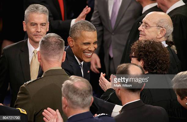 S President Barack Obama greets members of congress including US Supreme Court Associate Justice Sonia Sotomayor as he arrives to deliver his State...