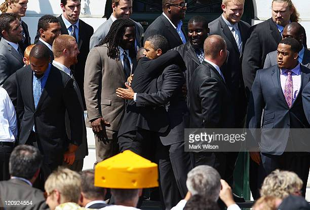 S President Barack Obama greets members of the Green Bay Packers during a reception for the National Football League Super Bowl XLV champions on the...