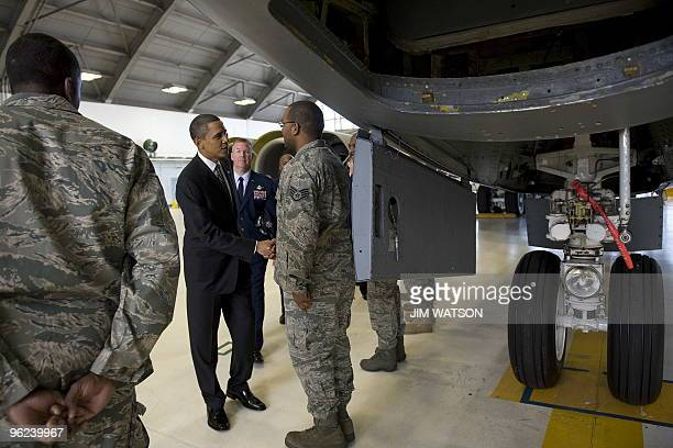 US President Barack Obama greets members of the US Air Force as he tours a maintenance hangar for a KC135 Stratotanker as he arrives at MacDill Air...