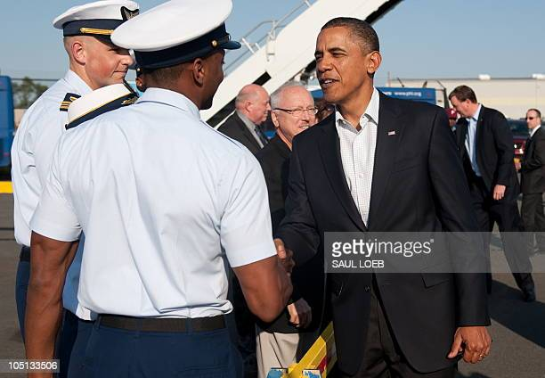 US President Barack Obama greets members of the US military on the tarmac upon arrival on Air Force One at Philadelphia International Airport in...