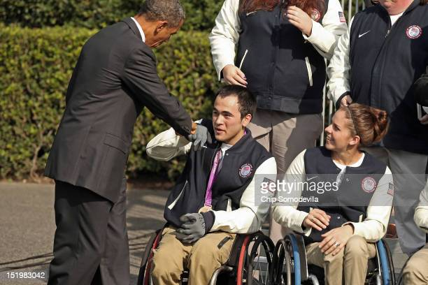 S President Barack Obama greets members of the US Olympic and Paralympic teams to the White House September 14 2012 in Washington DC The US team...
