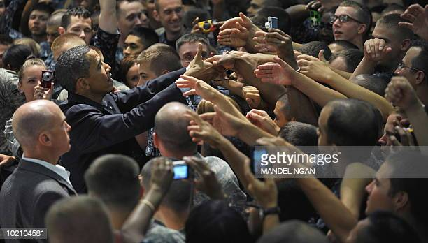 US President Barack Obama greets military personnel at the Naval Air Technical Training Center at Pensacola Naval Air Station June 15 2010 in...
