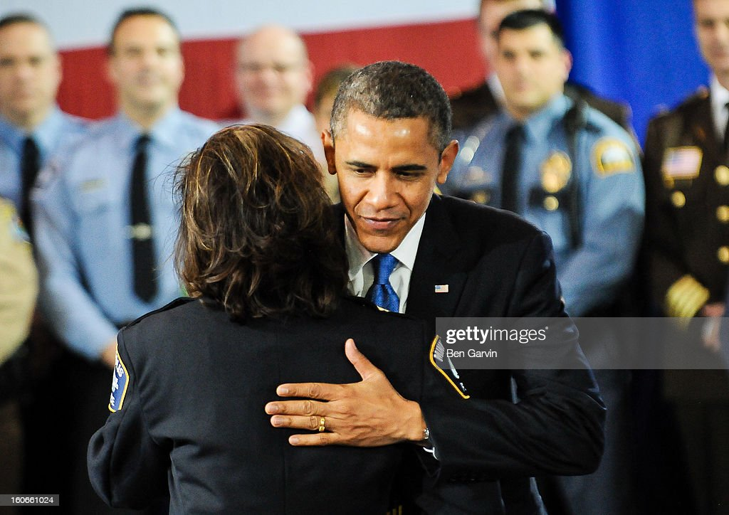 President Barack Obama greets Minneapolis Police Chief Janee Harteau, who introduced the President, after speaking before a group of local leaders and law enforcement officials at the Minneapolis Police Department Special Operations Center on February 4, 2013 in Minneapolis, Minnesota. President Obama is promoting a ban on assault weapons and expanded background checks on gun buyers.