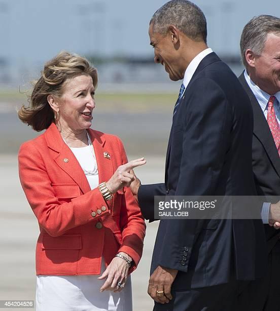 US President Barack Obama greets North Carolina Democratic Senator Kay Hagan upon arrival at Charlotte Douglas International Airport in Charlotte...
