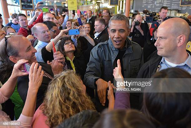 President Barack Obama greets patrons at the Snow City Cafe on September 1, 2015 in Anchorage, Alaska. Obama is heading to Seward, Alaska to visit...