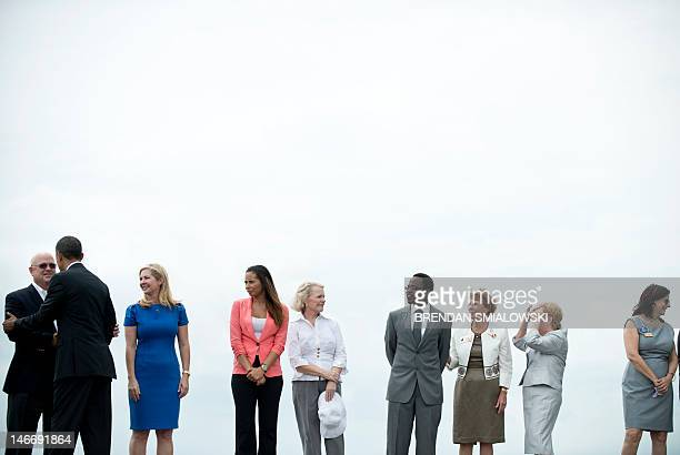 US President Barack Obama greets people after arriving at Tampa International Airport on June 22 2012 in Tampa Florida Obama is in Florida to attend...