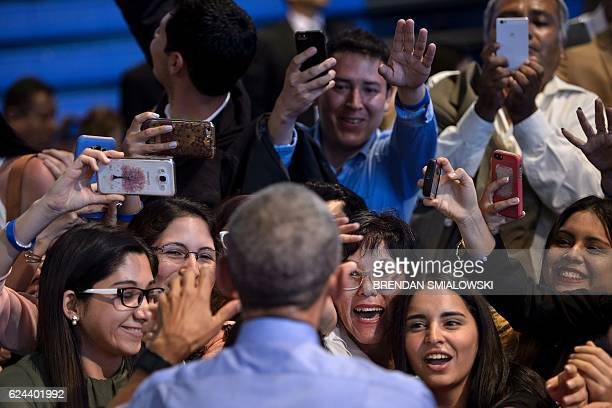 US President Barack Obama greets people after speaking at a Young Leaders of the Americas Initiative town hall meeting at the Pontifical Catholic...
