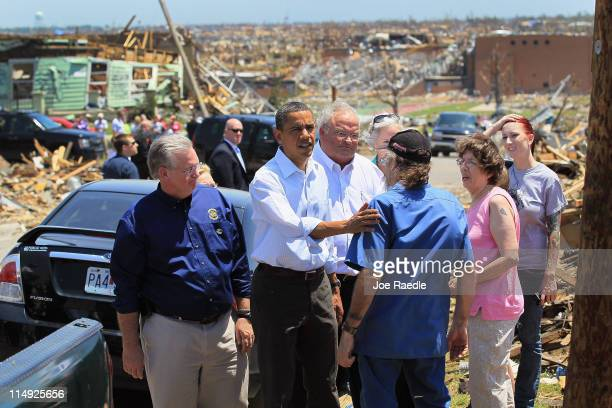 President Barack Obama greets people as he pays a visit to the community that was devastated a week ago by a tornado on May 29, 2011 in Joplin,...