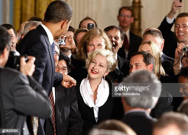 S President Barack Obama greets pop music artist Cyndi Lauper after delivering remarks following the enactment of the Matthew Shepard and James Byrd...