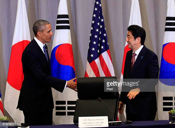 President Barack Obama greets Prime Minister Shinzo Abe of Japan during a meeting at the Nuclear Security Summit March 31, 2016 in Washington, DC....