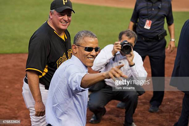 President Barack Obama greets Rep Mike Doyle DPa during the 54th Congressional Baseball Game in Nationals Park June 11 2014 The Democrats prevailed...