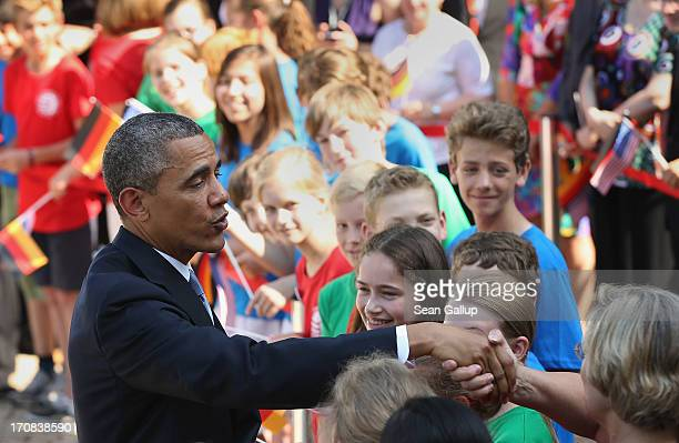 President Barack Obama greets schoolchildren from a local German-American school at Bellevue Palace on June 19, 2013 in Berlin, Germany. Obama is...