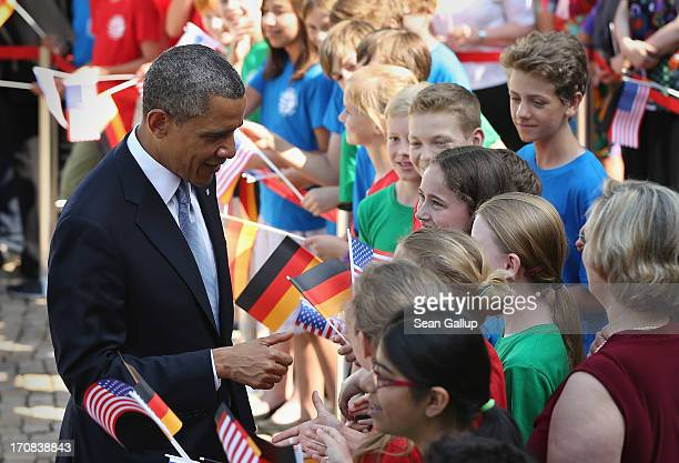 S President Barack Obama greets schoolchildren from a local GermanAmerican school at Bellevue Palace on June 19 2013 in Berlin Germany Obama is...