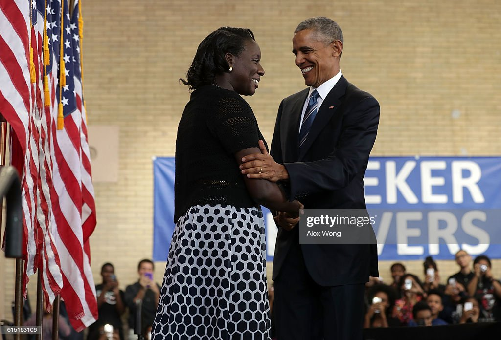 U.S. President Barack Obama (R) greets senior Ifunanyachukwu Azikiwe (L) after he was introduced by her during an event at Benjamin Banneker Academic High School on October 17, 2016 in Washington, DC. President Obama delivered remarks to highlight the progress he has made to improve education across the country including a rise in high school graduation rates.