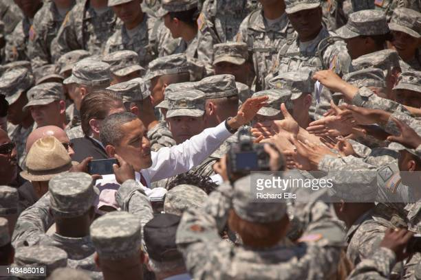 President Barack Obama greets soldiers after signing an executive order requiring more disclosure by colleges at Fort Stewart army base on April 27,...