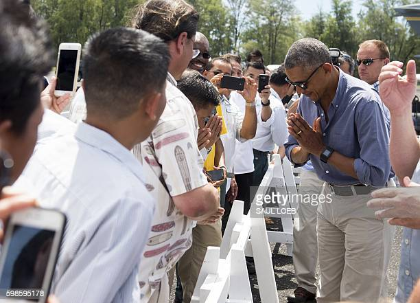 US President Barack Obama greets some of the residents of the island during a tour of Midway Atoll in the Papahanaumokuakea Marine National Monument...