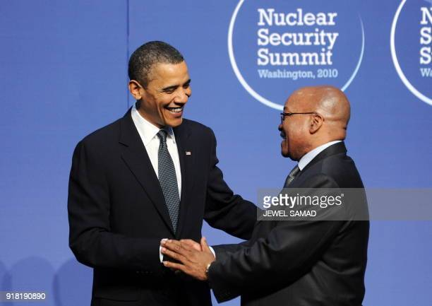 US President Barack Obama greets South African President Jacob Zuma before a dinner at the Washington Convention Center during the Nuclear Security...