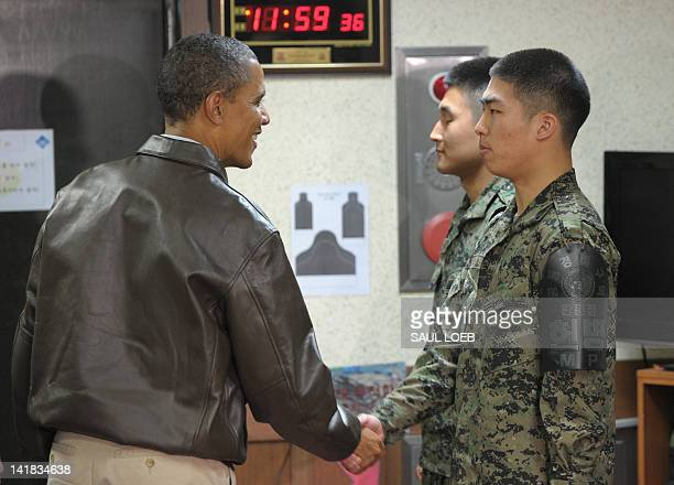 US President Barack Obama greets South Korean soldiers at Observation Post Ouellette during a visit to the Joint Security Area of the Demilitarized...