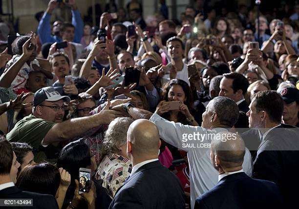 US President Barack Obama greets supporters after addressing a campaign event for Democratic presidential nominee Hillary Clinton at the Capital...