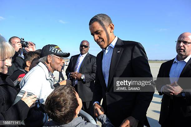 US President Barack Obama greets supporters after disembarking from Air Force One at Rickenbacker International Airport in Columbus Ohio on November...
