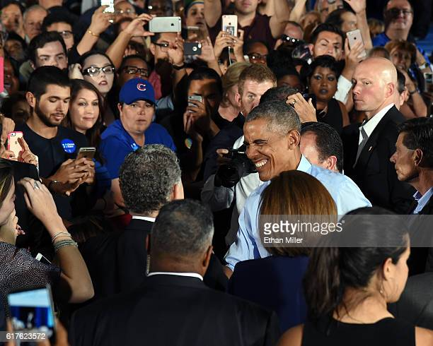 S President Barack Obama greets supporters after speaking at a campaign rally for Democratic presidential nominee Hillary Clinton at Cheyenne High...