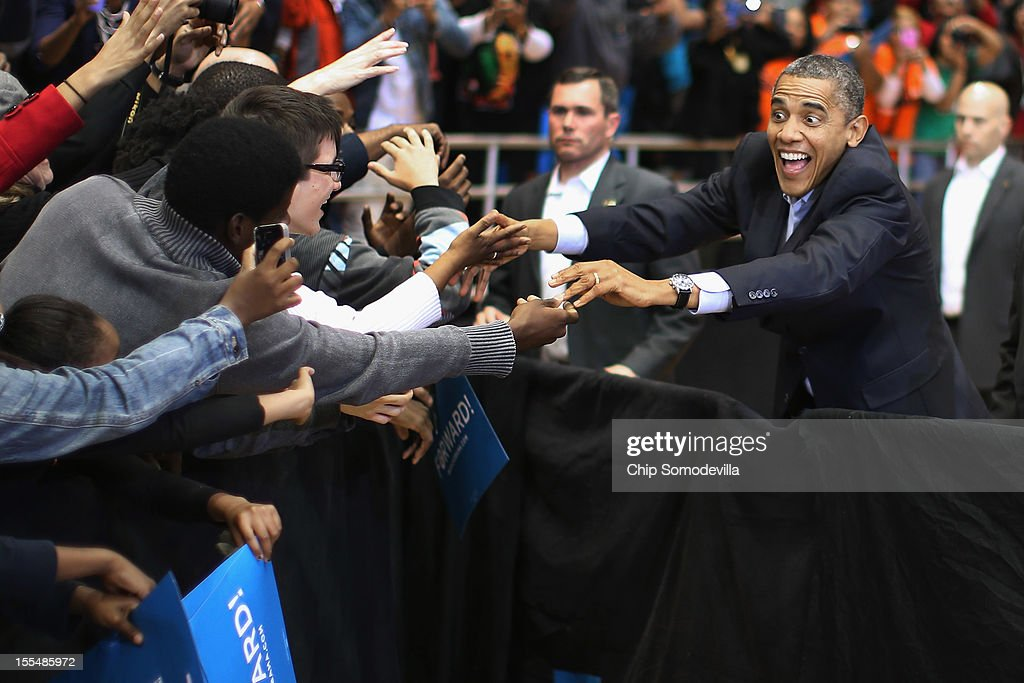 U.S. President Barack Obama greets supporters as he arrives for a campaign rally at Fifth Third Arena on the campus of the University of Cincinnati November 4, 2012 in Cincinnati, Ohio. With only two days left in the presidential election, Obama and his opponent, former Massachusetts Gov. Mitt Romney are stumping from one 'swing state' to the next in a last-minute rush to persuade undecided voters.