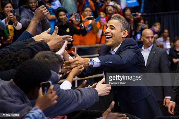 President Barack Obama greets supporters at a campaign rally at the in Cincinnati OH