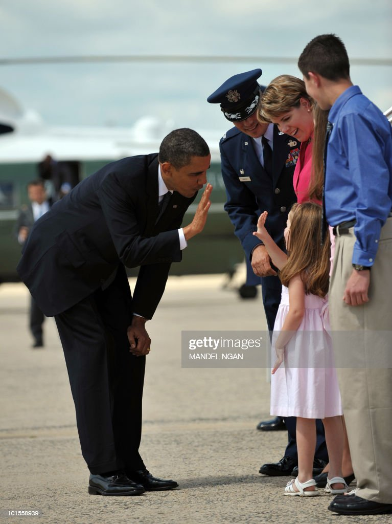 US President Barack Obama greets Susie Lambert, the daughter of retiring Col Kit Lambert (L), before boarding Air Force One on May 25, 2010 at Andrews Air Force Base in Maryland. Obama is heading to San Francisco to attend fundraisers for Senator Barbara Boxer and the Democratic Senatorial Campaign Committee. AFP PHOTO/Mandel NGAN