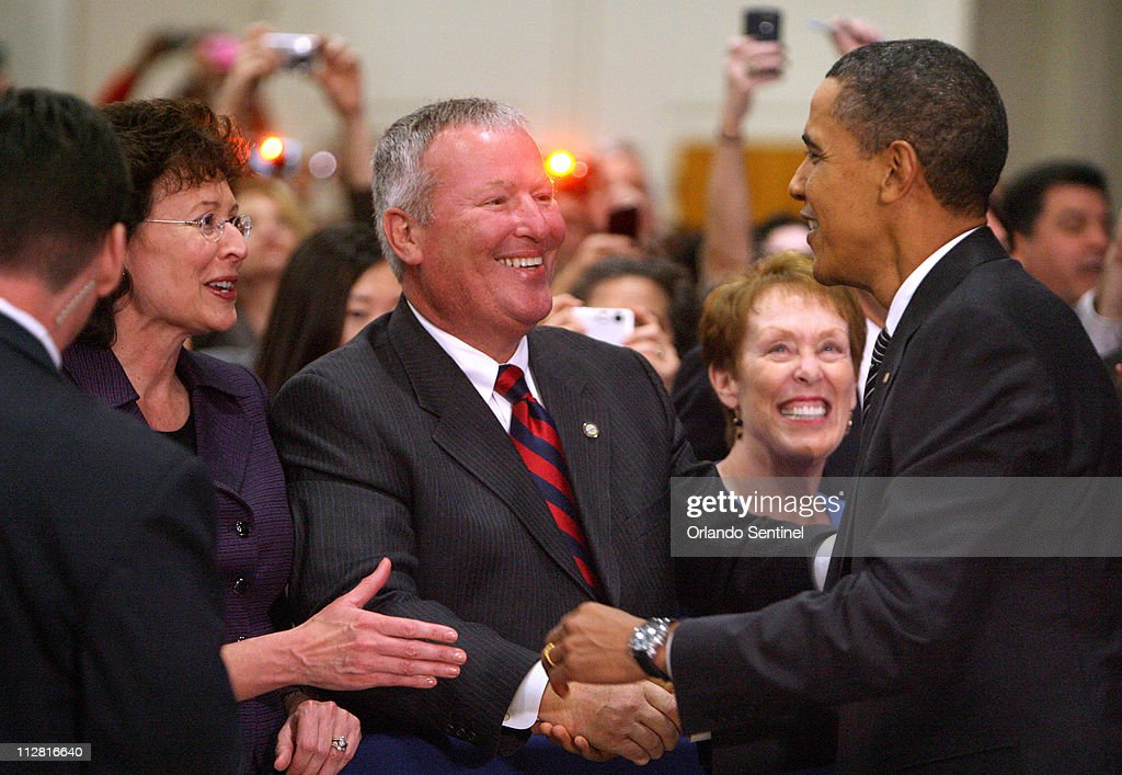 President barack obama greets tampa mayor pam iorio and orlando president barack obama greets tampa mayor pam iorio and orlando mayor buddy dyer center on his way to the stage at the start of his town hall meeting at m4hsunfo Image collections