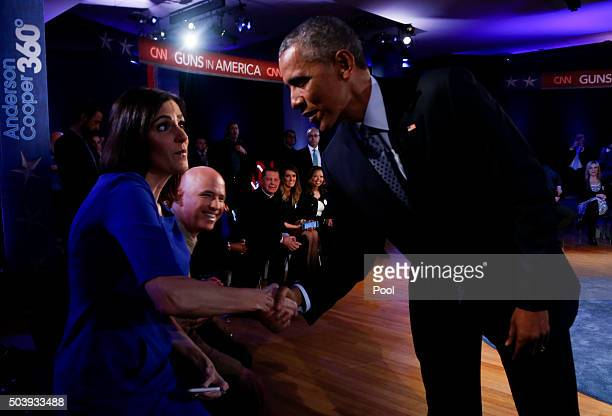 US President Barack Obama greets Taya Kyle widow of US Navy SEAL Chris Kyle during a commercial break at town hall at George Mason University on...