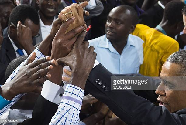 US President Barack Obama greets the crowd after speaking at Safaricom Indoor Arena in Nairobi on July 26 2015 Obama arrived on July 24 in the Kenyan...