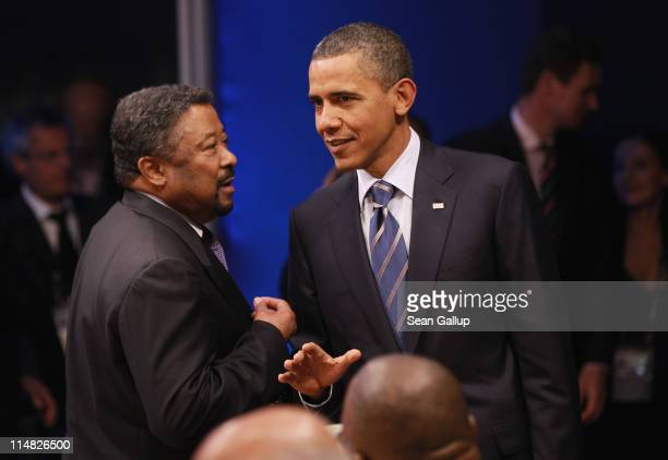 S President Barack Obama greets the President of the Commission of the African Union Jean Ping at a meeting of G8 leaders and African leaders on the...