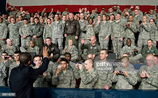 President Barack Obama greets troops during a rally with US troops at Elmendorf Air Force Base in Anchorage, Alaska, November 12, 2009. The stopover...