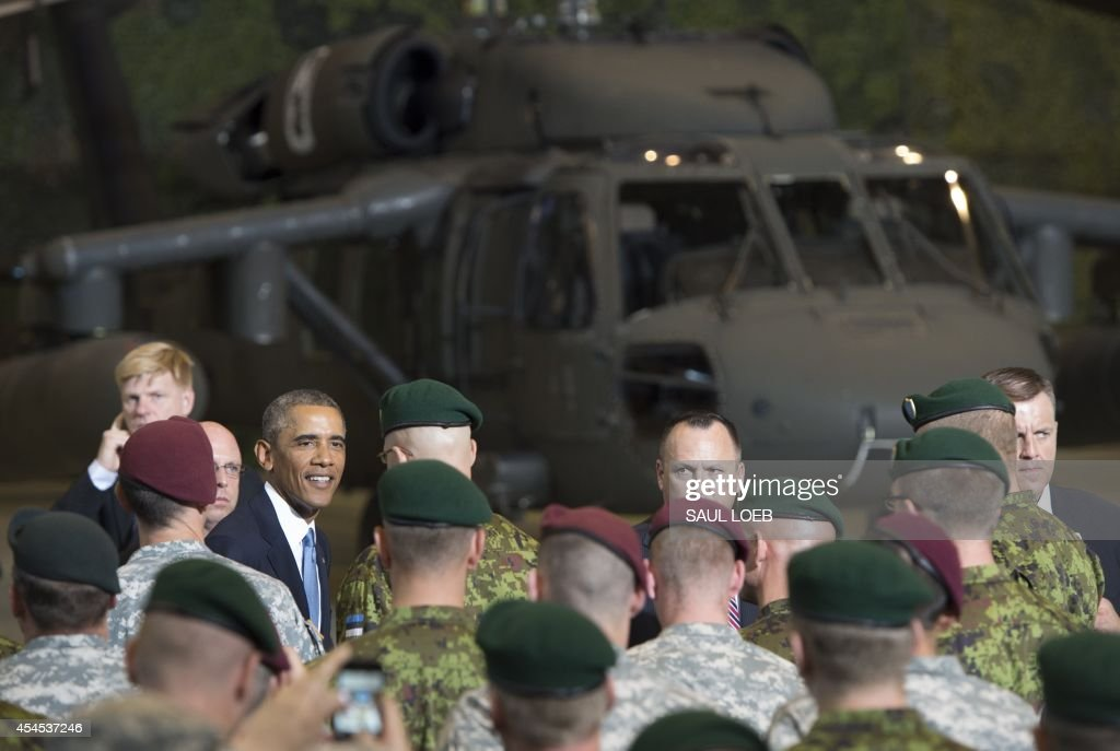 US President Barack Obama greets US and Estonian members of the military at a hangar after delivering a speech at Tallinn Airport in Tallinn, Estonia, September 3, 2014. US President Barack Obama underscored Washington's commitment to the security of NATO allies, announcing additional US planes to police the skies over Europe's eastern flank bordering Russia.