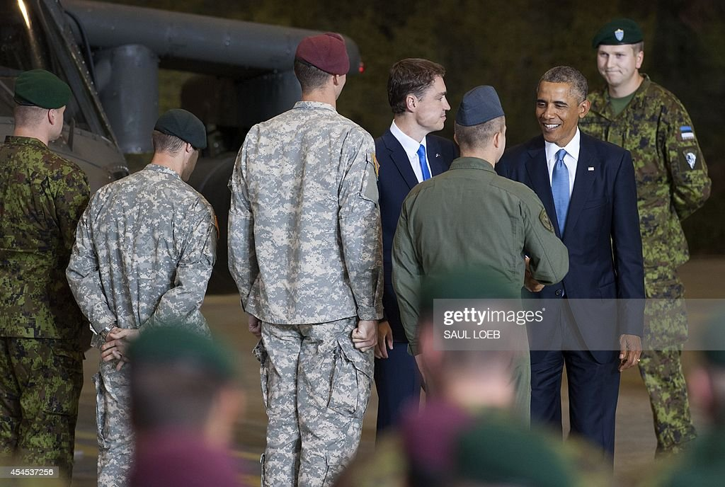 US President Barack Obama (2R) greets US and Estonian members of the military next to Estonian Prime Minister Taavi Roivas at a hangar after delivering a speech at Tallinn Airport in Tallinn, Estonia, September 3, 2014. US President Barack Obama underscored Washington's commitment to the security of NATO allies, announcing additional US planes to police the skies over Europe's eastern flank bordering Russia.