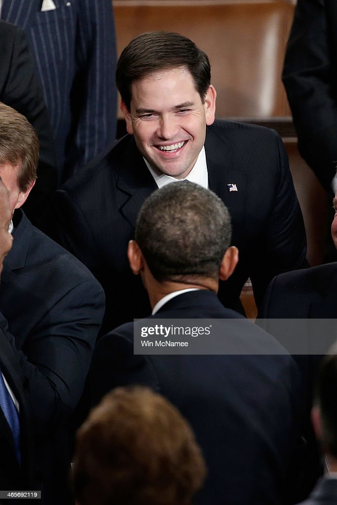 U.S. President Barack Obama greets U.S. Sen Marco Rubio (R-FL) (top) before delivering the State of the Union address to a joint session of Congress in the House Chamber at the U.S. Capitol on January 28, 2014 in Washington, DC. In his fifth State of the Union address, Obama is expected to emphasize on healthcare, economic fairness and new initiatives designed to stimulate the U.S. economy with bipartisan cooperation.