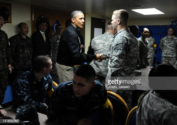 US President Barack Obama greets US troops at army base Camp Bonifas in Paju during a visit to the Demilitarized Zone on the border between North and...