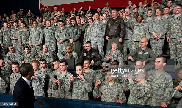 President Barack Obama greets US troops during a rally at Elmendorf Air Force Base in Anchorage, Alaska, November 12, 2009. The stopover marks...