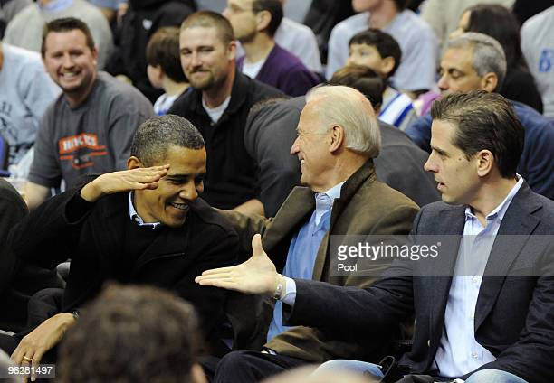 US President Barack Obama greets Vice President Joe Biden and his son Hunter Biden as they attend the game between the Duke Blue Devils and...