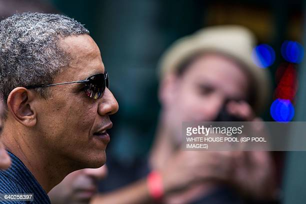 US President Barack Obama greets wellwishers outside of Island Snow at Kailua Beach Center on Tuesday Dec 31 2013 The First Family is in Hawaii for...