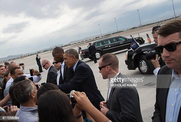 US President Barack Obama greets wellwishers upon arrival at McCarran International Airport in Las Vegas on October 23 2016 to attend a campaign...