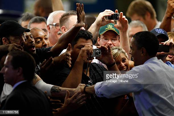 President Barack Obama greets workers as he enters Ford's Torrence Avenue assembly plant on Chicago's South Side Thursday August 5 2010 Ford will go...