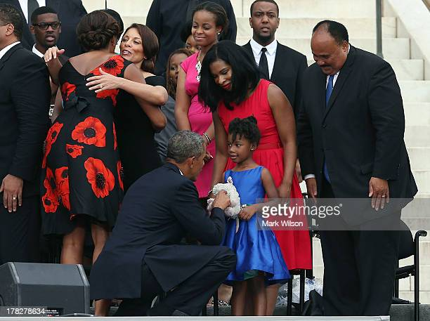 S President Barack Obama greets Yolanda King dauther of Martin Luther King III his wife Arndrea King during a ceremony to commemorate the 50th...