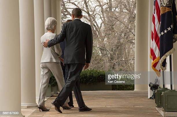US President Barack Obama guides Health and Human Services Secretary Kathleen Sebelius following remarks in the Rose Garden of the White House April...