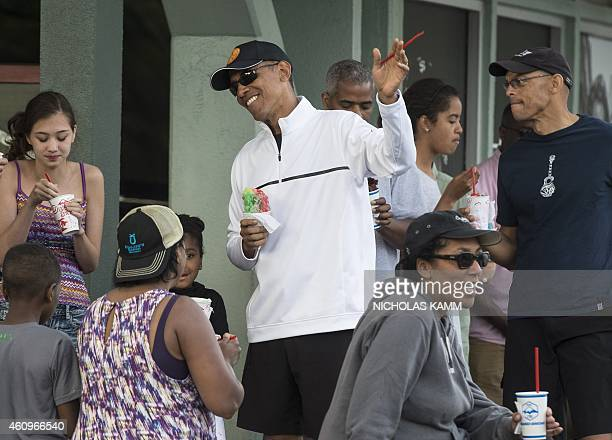President Barack Obama has shave ice with his daughter Malia and friends at Island Snow in Kailua on January 1, 2015. AFP PHOTO/NICHOLAS KAMM