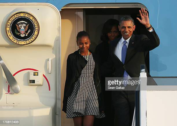 S President Barack Obama his wife Michelle and their daughters Sasha and Malia emerge from Air Force One upon their arrival at Tegel airport on June...