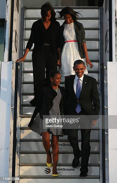 S President Barack Obama his wife Michelle and their daughters Sasha and Malia descend from Air Force One upon their arrival at Tegel airport on June...