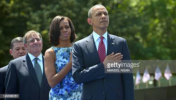 US President Barack Obama his wife Michelle Defense Secretary Leon Panetta and Veteran's Administration Secretary Eric Shinsecki stand for the...